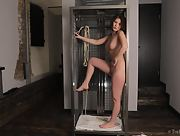 Tied up brunette unleashes herself gets naked and pleases herself with nice fingering