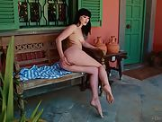 Top class model Malena works her sweet shaved love hole outside on the porch
