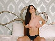 Beautiful small titted brunette Leona Mia masturbates in the bedroom