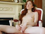 Small titted Jia Lissa is feeling horny by the fireplace