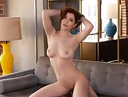 Skye Blue is at home stripping and posing naked on the grey couch