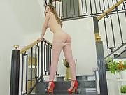 Satin Stone hot chick pulls up her red skirt and masturbates on the stairs