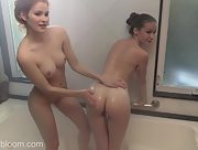 Emily Bloom and fabulous redhead beauty Heidi Romanova have fun under the shower