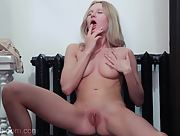 Amazing skinny babe Celia spreads her legs to show us her perfectly shaved pink pussy
