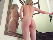 Blonde bombshell Kery teases her magnificent body in front of the mirror