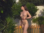 Lovely and sexy chick Satin takes off her white shirt and masturbates on the grass