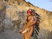 Sweet chick with a lot to show poses sensually in indians costume