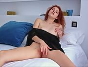 Charming young babe with redhead masturbates on the bed