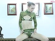 Skinny lady takes off her tight green clothes and poses naked passionately