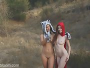 Sweet and playful babes Emily Bloom and Jewels poses in nature in sexy costumes