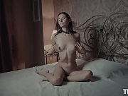 Cristin skinny chick in chains works her pussy on the bed till she cums