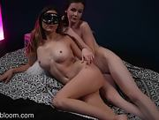 Emily Bloom and her seductive girlfriend with mask poses naked as they play pinball