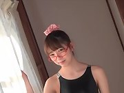 Smoking charmer Aya Otani shows her attractive young body in Glittery Glossy Swimsuit Scene 2