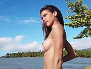 Stunning chick takes her red swimsuit off and shows her perfect body on the seashore