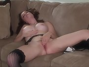 Sweet brunette Holly Hansen is all about touching her pink and hairy pussy on the sofa