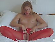 Jade is on the bed working her pussy through her ripped red pantyhose