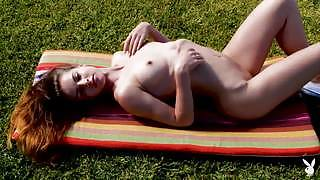 Stunning brunette gets naked and shows off her sexy body as she poses in nature
