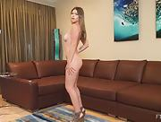 Bloomed girl Leah gets naked and shows her mind-blowing sex appeal in Leggy Sensual Fun