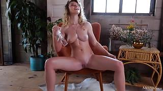 Magnificent female with a perfect figure gets wet on the armchair
