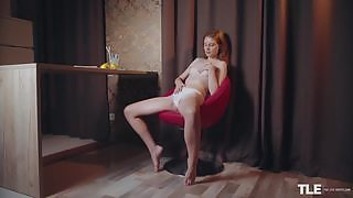 Chick with perky tits is home alone ready for some solo pussy play on the chair