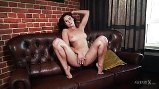 Mara Blake satisfies her masturbation urge on the couch for the camera