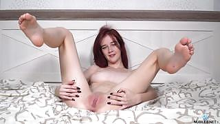 Tempting and playful vixen Kira Cute nude in Red Hot