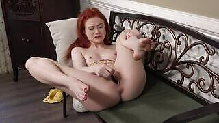 Scarlet Skies stuffing her tight vagina with a black vibrator in front of the camera